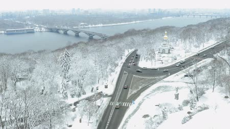 nadir : Rare winter landscape with a church by the river. Snowy landscape Stok Video