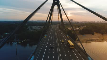kyiv : Flying above the road on the bridge at golden dusk. Aerial footage Stock Footage