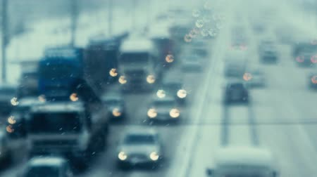 otoyol : Road traffic with cars and trucks in defocus during a snowstorm