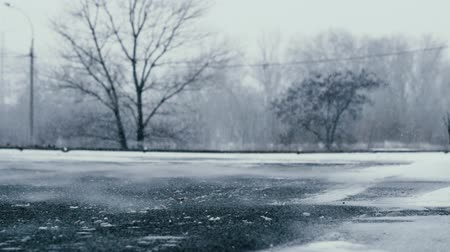 abandonment : Wind sweeps the snow along the lonely road. Loneliness and abandonment concept Stock Footage