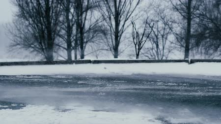 abandonment : Snowstorm in the city street. Loneliness and abandonment concept Stock Footage