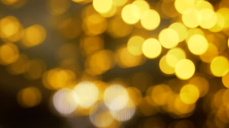 filtro : Yellow Christmas illumination in defocus. Bokeh background. Out of focus