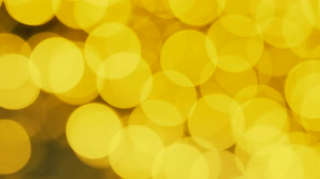 glittery : Yellow christmas bokeh. Abstract blurred background. Out of focus