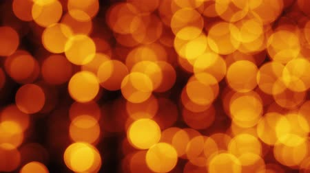 glittery : Orange Christmas illumination in defocus. Blurry bokeh lights. Out of focus