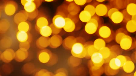glittery : Blurred Golden christmas lights bokeh background. Party illumination. Out of focus