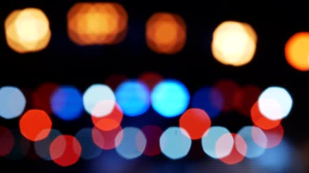 glittery : Bokeh city lights. Defocused night life background. Out of focus