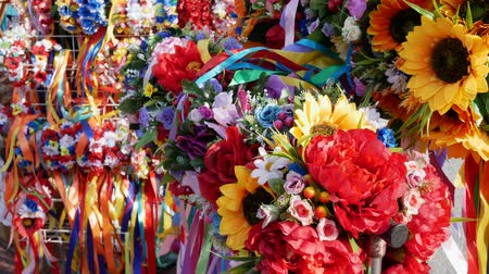 flat head : Ukrainian wreaths on the head with ribbons for sale. Close up Stock Footage