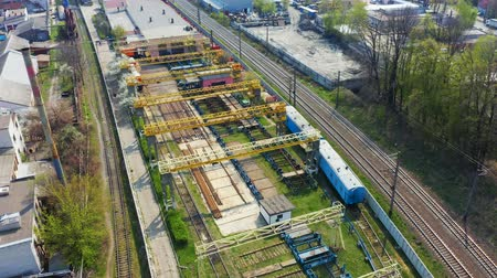 Fly over railway in the industrial area of the city. Aerial footage Vídeos