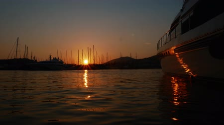 urban exploration : Time lapse sunrise in the port of the resort town of Bodrum, Turkey. Luxury yacht moored in the bay. Travel concept Stock Footage