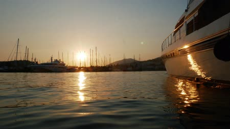 urban exploration : Time lapse sunset in the port of the resort town of Bodrum, Turkey. Luxury yacht moored in the bay. Travel concept