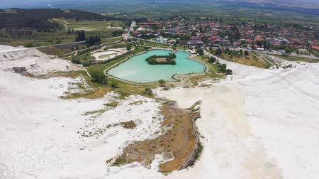 kalcium : Aerial view of park at Mount Pamukkale. Swimming pool, panoramic views and a cafe at the lake 4k