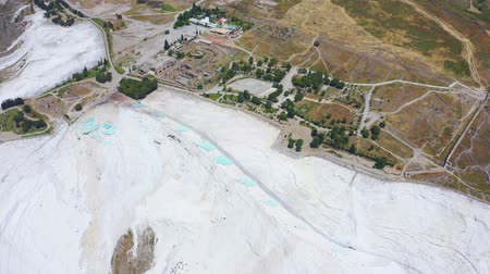 Эгейский : Top aerial view of Pamukkale in Turkey aka Cotton Castle. Mineral bath spas that abound the province of Denizli 4k