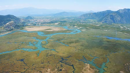 égei : Aerial survay of the river and city Dalyan, Turkey. The river that flows into the Aegean and the Mediterranean 4k