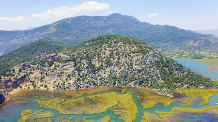 Эгейский : Aerial footage of mountain range near the river Dalyan in Turkey. Zoom in 4k