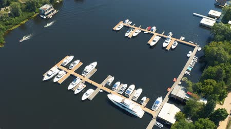 White yachts moored at the boat station. Early morning in summer. Aerial footage 4k