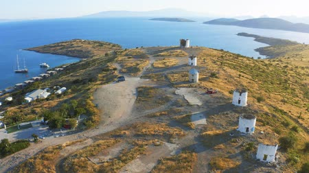 bodrum : Aerial survay over windmills in Bodrum, Turkey. Spectacular landscape at sunset. Welcome to Turkey concept 4k