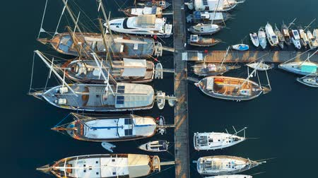 Yachts, ships and boats moored in port. View from above. Aerial footage 4k Vídeos