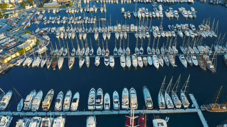 Fly over an elite yachts moored in the port. View from above 4k Vídeos