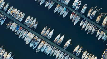 Birds eye view of an elite yachts moored in the port. Aerial footage 4k