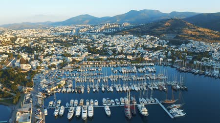 halicarnassus : Aerial footage of an elite yachts moored in port. Resort town Bodrum, Turkey. View from above. Overall plan 4k
