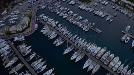 парусное судно : Fly over an elite yachts moored in the port eary in the morning. View from above 4k