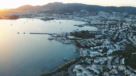 Bay in the Aegean Sea in the rays of sunset. Bodrum, Turkey. Aerial footage 4k Vídeos