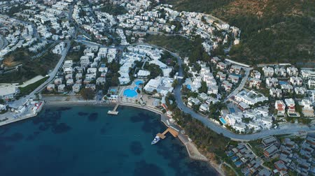 Aerial top view of the hotel with white houses and swimming pool. Bodrum, Turkey 4k Vídeos