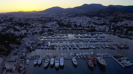 halicarnassus : Aerial footage of an elite yachts moored in port at the sunset. Resort town Bodrum, Turkey. Overall plan 4k