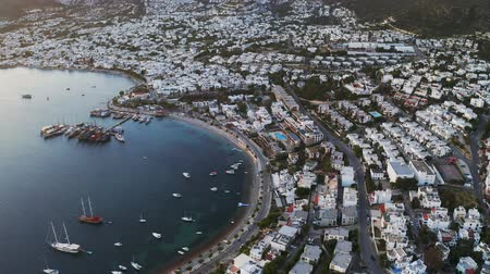 Aerial view of Bodrum (Halicarnassus) bay with white houses at the sunset 4k