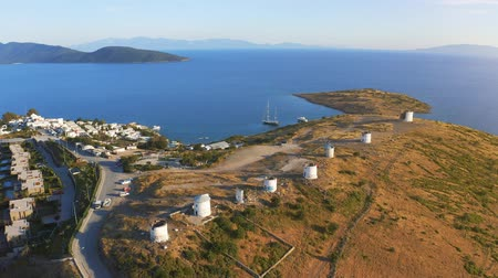 aegean sea : Flying over windmills in Bodrum, Turkey. Spectacular picture at sunset. Welcome to Turkey concept. Aerial 4k