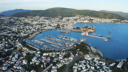 aegean sea : Aerial view of Marina Harbor in Bodrum, Turkey. Luxury yachts are in the seaport surrounded by hilly terrain 4k