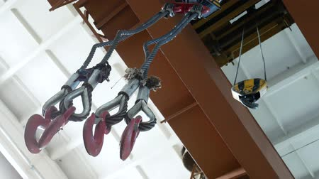 hydraulic : Metal hooks of the cargo crane. Work in the warehouse of metal, transportation of products 4k Stock Footage