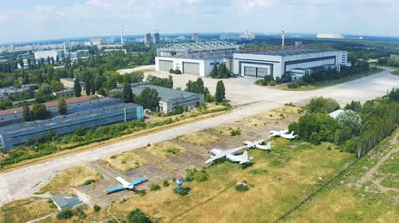 preventive : Antonov aircraft factory in Kiev. Shooting from the sky. Museum exhibits of Antonov aircraft near the hangar 4k Stock Footage