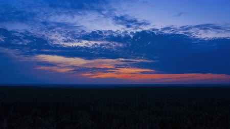 flat lay : Spectacular timelapse of the sunset above the forest. Aerial hyperlapse 4k