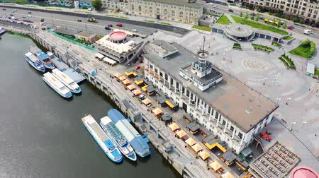 kiev : Aerial view of river pier in Kiev. Postal Square in the capital of Ukraine. River trams and boats moored in the port. Tourist place in Podil 4k Stock Footage