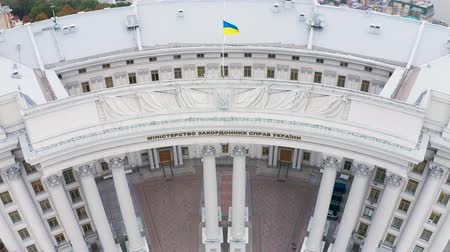 kolumny : Building of the Ministry of Foreign Affairs of Ukraine with a waving flag on top. Aerial footage. Tilting down shot 4k