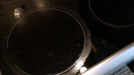 gas hob : Moving over a dirty hob. Plate surface with scale traces. Close up 4k Stock Footage