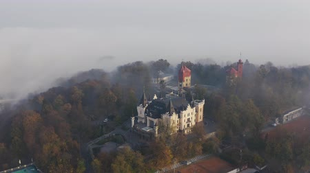 magic kingdom : A small castle on the mountain during foggy weather. Castle standing on the hill in Kiev 4k Stock Footage