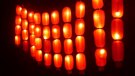 lunar : Chinese lanterns. Festive red lights night street Asia. Traditional Festive New Year Decor. Night illumination. Perspective view 4k
