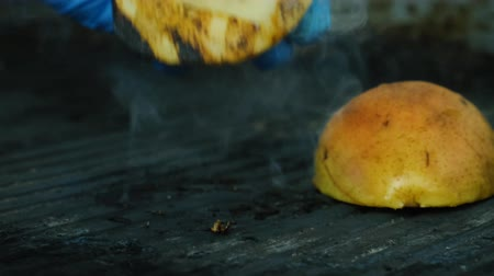being prepared : Pear is being fried on a grill. Sweet dish. Close up 4k