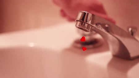 приехать : The hand opens the tap from which come out many red hearts