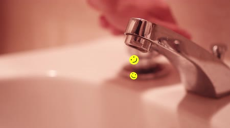 su tesisatı : Yellow smileys flow from the open faucet
