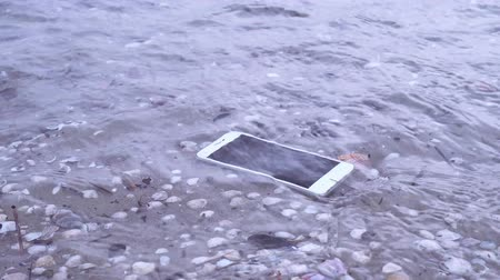 kap : Smartphone falls in river or sea water