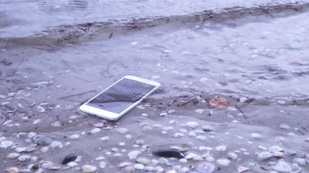 kap : Smartphone falls in the sea water