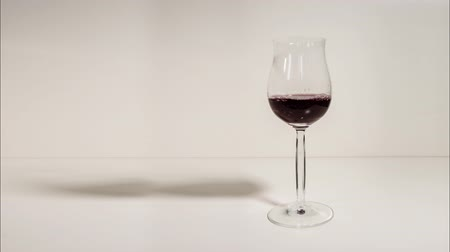 goblet : A glass goblet is filled with red wine Stock Footage