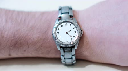 minute : Wrist watch in timelapse on the hand
