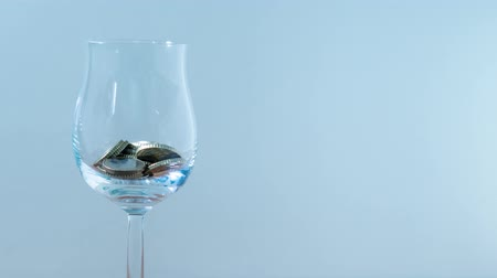 buy gold : Coins fill glass goblet in stop motion Stock Footage