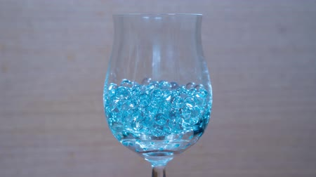 boncuklar : Glass beads in the goblet Stok Video