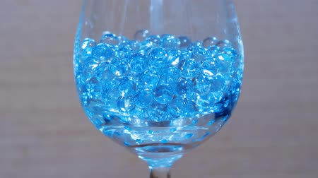 stop motion : Glass beads in the goblet Stock Footage
