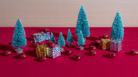 Small Christmas trees with gifts and decorations Stockvideo